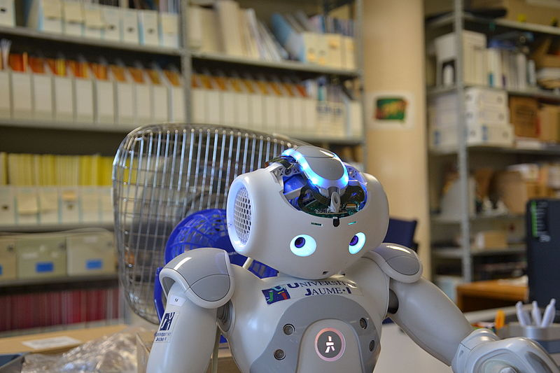 A modern robot is shown in a lab