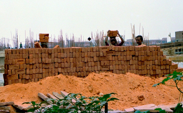 India used to have a rigid caste system. The people in the lowest caste suffered from extreme poverty and were shunned by society. Some aspects of India's defunct caste system remain socially relevant. In this photo, Indian women of a specific Hindu caste works in construction, and demolishes and builds houses.