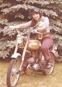 Nancy Caroline sitting on motorcycle