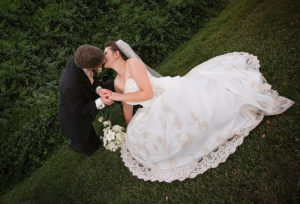A bride and groom kiss.