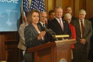 Nancy Pelosi speaks in front of a group of people