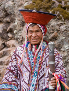 A man from the Andes Mountains is dressed in traditional attire.