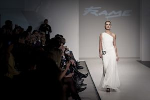 A model is walking the runway at a fashion show