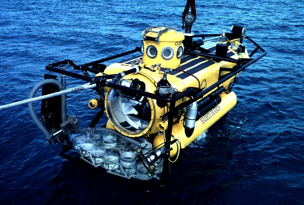 a yellow Submersible with lights on it