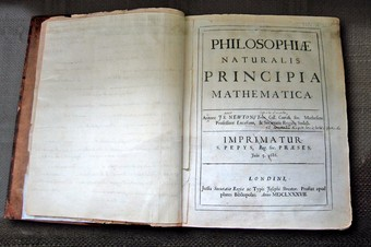 Isaac Newton's Principia, developed the first set of unified scientific laws