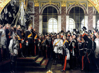 18 January 1871: The proclamation of the German Empire in the Hall of Mirrors at the Palace of Versailles. A large group of men, in formal military uniforms, gathered to proclaim the German Empire. Bismarck appears in white. The Grand Duke of Baden stands beside Wilhelm, leading the cheers. Crown Prince Friedrich, later Friedrich III, stands on his father's right. Painting by Anton von Werner.
