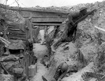 Trenches of the 11th Cheshire Regiment at Ovillers-la-Boisselle, on the Somme, July 1916. One sentry keeps watch while the others sleep.