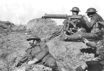 Photo of soldiers in a trench operating a large machine gun.