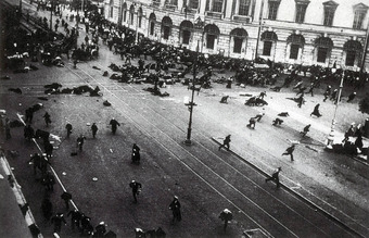 Photo shows people strewn across a large open street, some running, some injured or dead.