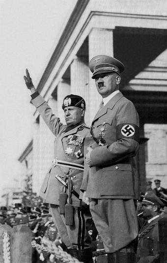 Photo of Hitler and Mussolini in official military uniforms overlooking a crowd of people.