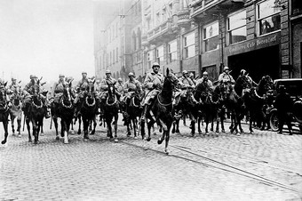 A photo of French cavalry marching through a German street during the Occupation of Ruhr.
