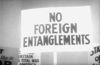 """A photo of a protester's sign reading """"No foreign entanglements."""""""