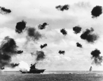 USS Yorktown ship just hit by torpedo fire, surrounded by smoke.