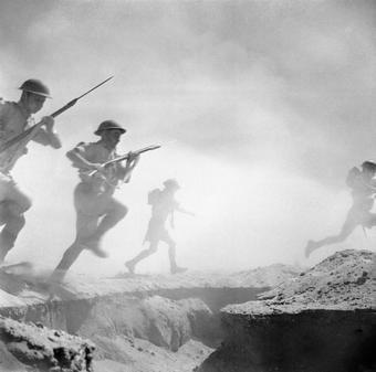 El Alamein 1942: British infantry advances through the dust and smoke of the battle.