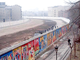 Image of the Berlin Wall covered in graffiti.