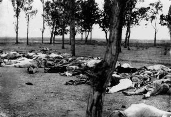 Photo of dead Armenians lying in a field in 1915 during mass deportations.