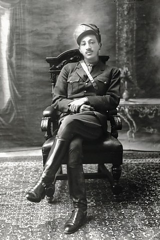 A photo of Zahir Shah, king of Afghanistan, seated in a chair in military attire.