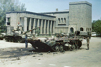 A photo of several tanks surrounding a building the day after the Marxist revolution on April 28, 1978.