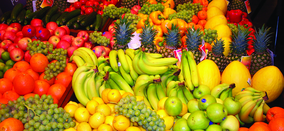 A photograph of different types of fruit at a market.