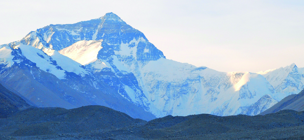 Photo shows a snow-covered mountain range.
