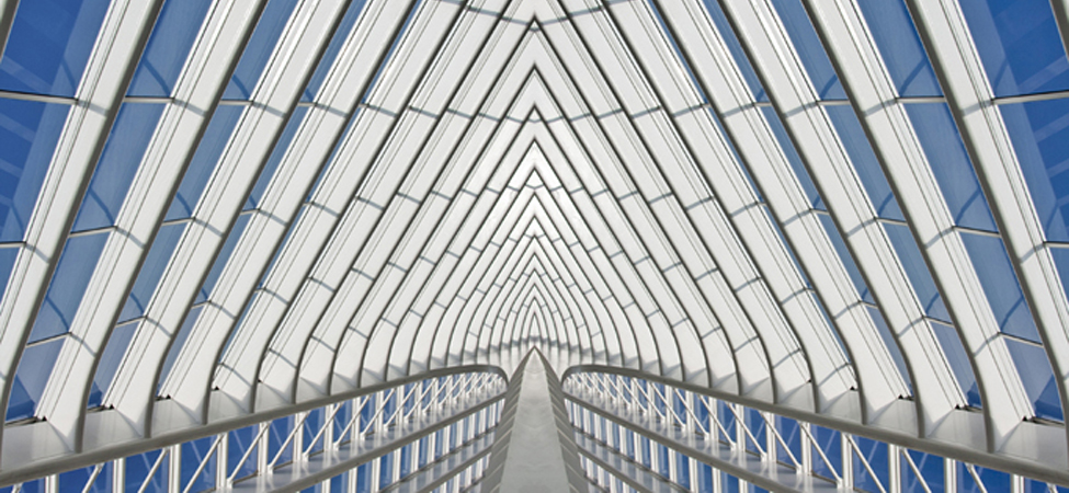 Part of a glass building is shown. The structure is made up of individual shapes.