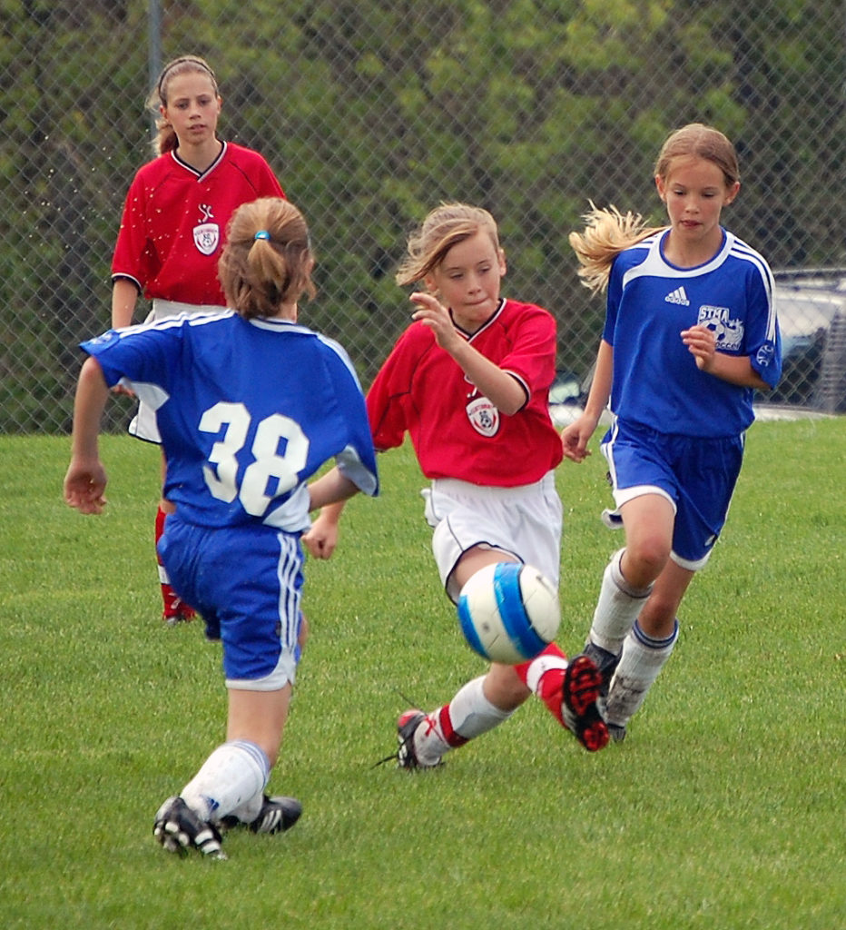 Middle school girls playing soccer