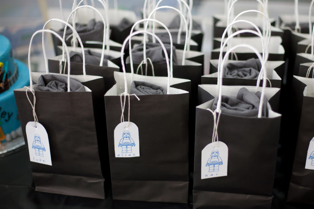 Rows of goodie bags on a table at a child's birthday party