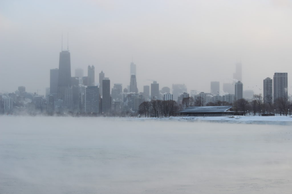 A photo of the Chicago skyline during a freezing, snowy winter