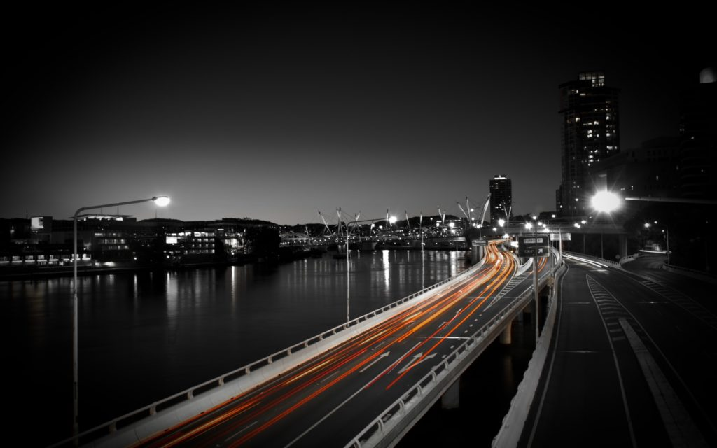 Highway into a city at night