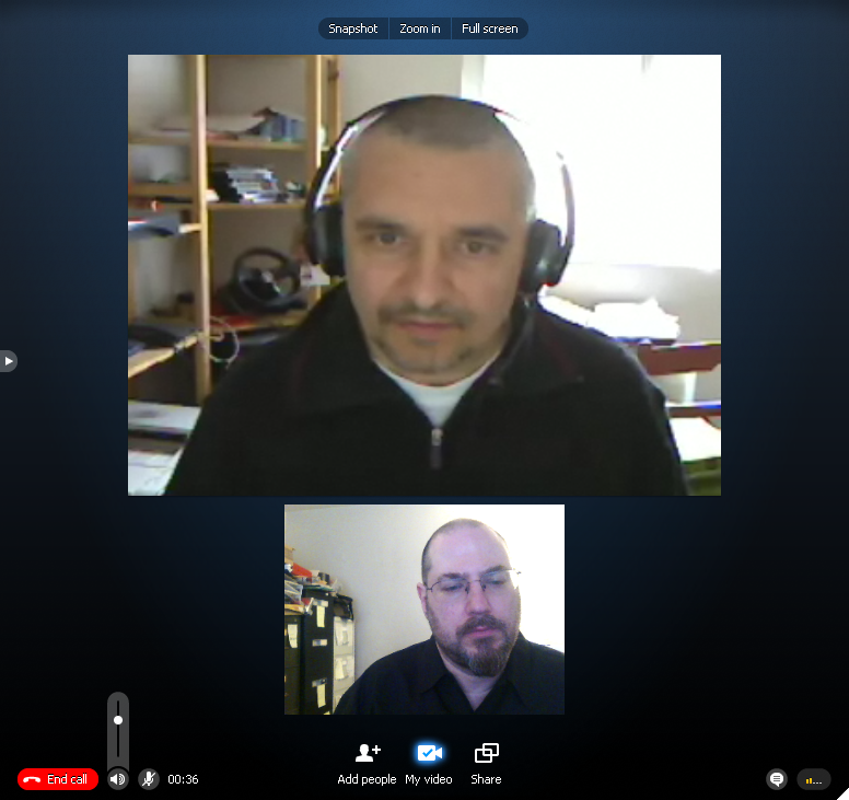 Two men video conferencing.