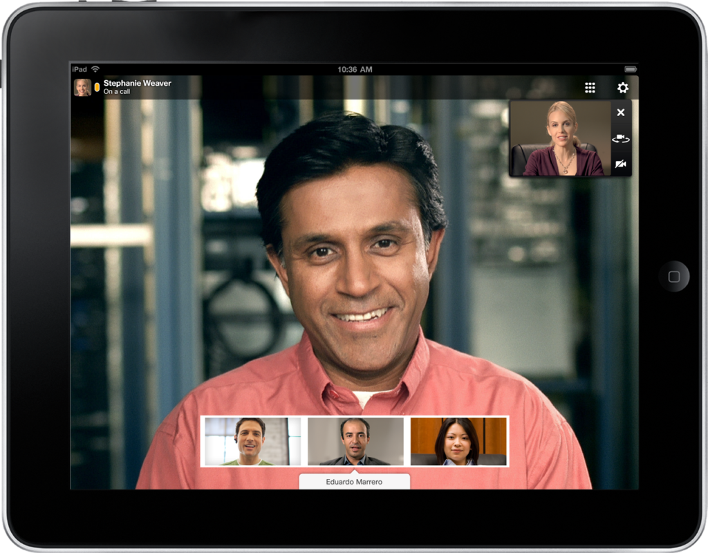 A group videoconferencing with five members present.