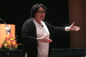 United States Supreme Court Justice Sonia Sotomayor speaking to attendees at the John P. Frank Memorial Lecture at Gammage Auditorium at Arizona State University in Tempe, Arizona while gesturing with her hands.