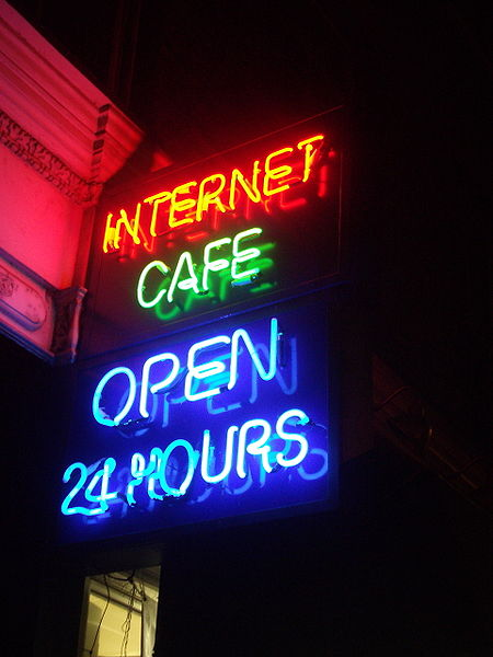 """The different colors of these """"neon"""" lights are caused by gases other than neon in the discharge tubes. Source: """"Neon Internet Cafe open 24 hours"""" by JustinC is licensed under the Creative Commons Attribution- Share Alike 2.0 Generic license."""