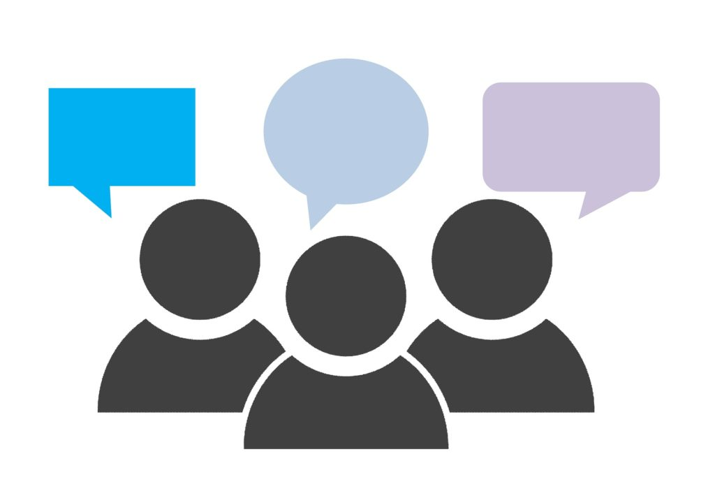 icon illustration of three people, each with a different coloured speech bubble. There is no text in the speech bubbles.
