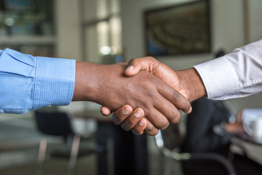 Two hands clasped in a handshake