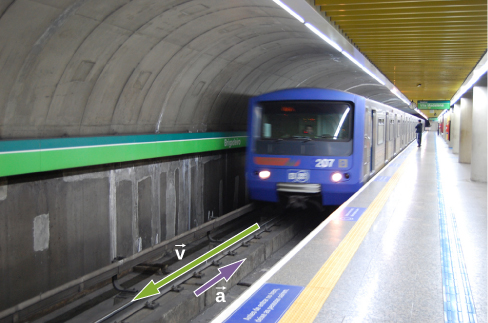 Picture shows a subway train coming into a station.