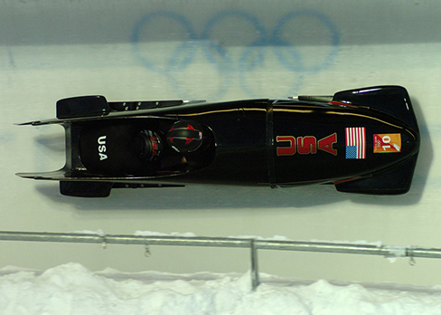 A photograph of a bobsled on a track at the Olympics.
