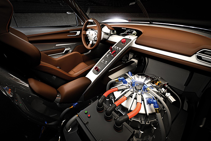 Figure is a photo of a kinetic energy recovery system flywheel installed next to the driver's seat in a car.