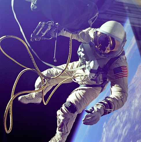 A photo of an astronaut on a spacewalk is shown.