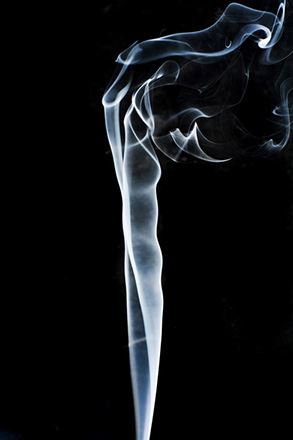 Figure is a photo of smoke that rises smoothly at the bottom and forms swirls and eddies at the top.