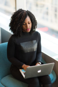 An entrepreneur working on her laptop.