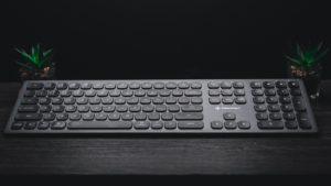 A keyboard sitting on a desk