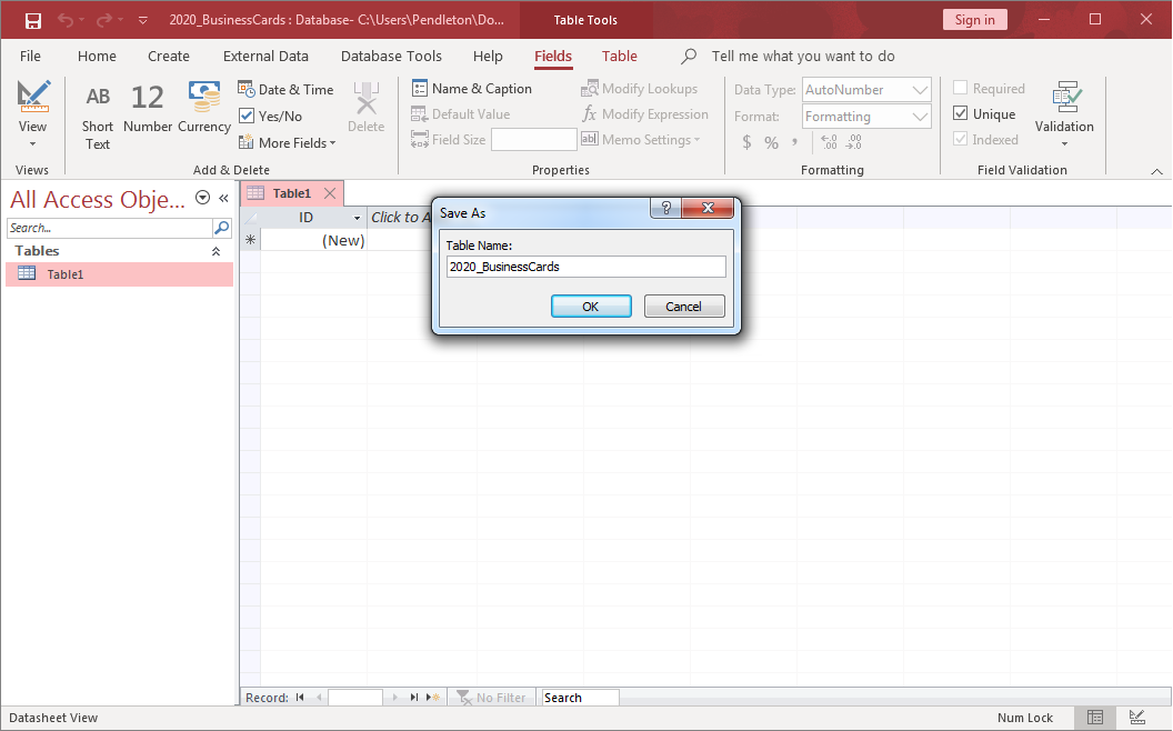 A blank database in Microsoft Access. A Save As dialog box is open, and a new table called 2020_BusinessCards is being created.