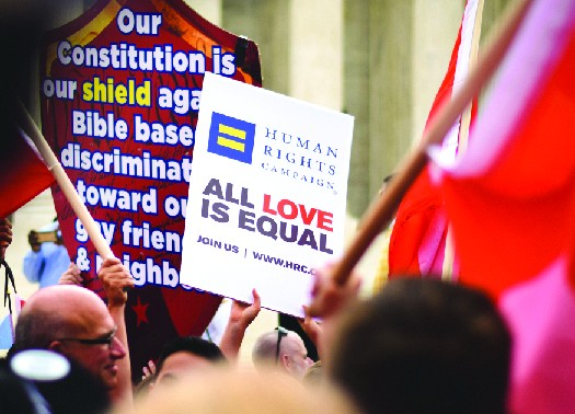 An image of a sign reading Human Rights Campaign All love is equal