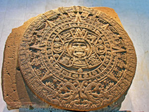 photo of stone relief carving, circular fragment, in the shape of an intricately carved sun