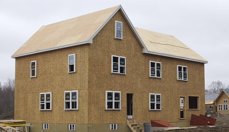 This photograph shows a new house under construction.