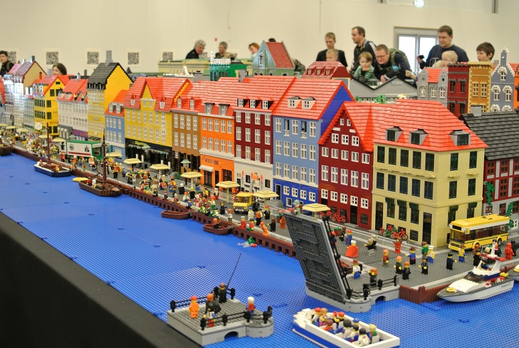 A photo of visitors at Legoland in Billund, Denmark. The Lego city scene in the photo is a Norwegian fishing village.