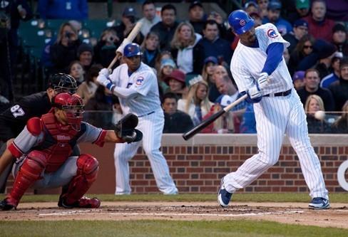 Photo of a baseball batter swinging.