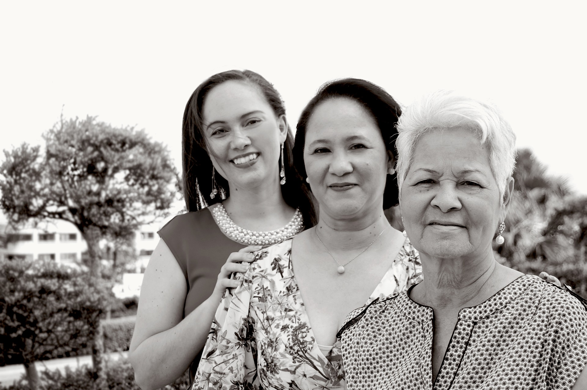 Three generations of women in a family: young adult, middle-aged mother, and older grandmother.