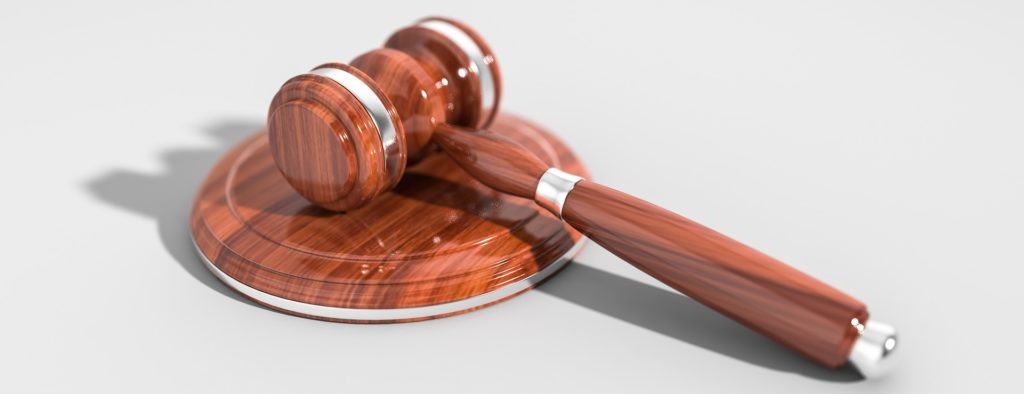 gavel on a disc of wood